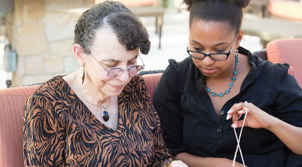 Young woman helping older woman